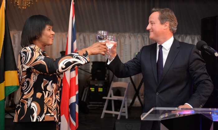Prime Minister, the Most Hon. Portia Simpson Miller (left), raises a toast to Prime Minister of the United Kingdom (UK), the Rt. Hon. David Cameron, during a reception in his honour at Vale Royal in Kingston yesterday (Sept. 29). Prime Minister Cameron departed the island this morning (Sept. 30), after a one day official visit.