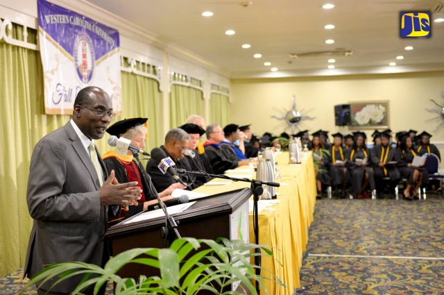 Education, Youth and Information Minister, Senator the Hon. Ruel Reid (left), addressing the audience at Western Carolina University's fall commencement, which was held at the Knutsford Court Hotel in New Kingston on Friday, October 21.