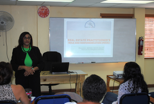 Chief Executive Officer of the Real Estate Board, Sandra Waston-Garrick, conducts a training session at the Real Estate Training Institute