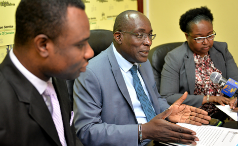 Minister of Education, Youth and Information, Senator the Hon. Ruel Reid (centre), addresses a JIS Think Tank on August 28. He is flanked by Permanent Secretary in the Ministry, Dean-Roy Bernard; and Chief Education Officer, Dr. Grace McLean.