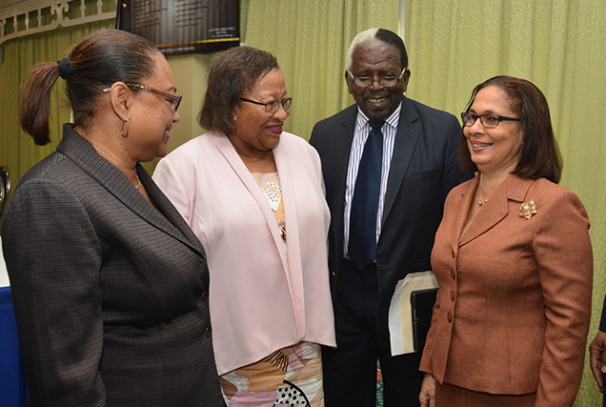 Minister of Labour and Social Security, Hon. Shahine Robinson (right), enjoys a light moment with Speaker of the House of Representatives, Hon. Pearnel Charles (second right); President of the Jamaica Confederation of Trade Unions, Helene Davis Whyte (left); and Chief Executive Officer of the Jamaica Employers' Federation, Brenda Cuthbert. Occasion was the Workers' Week Panel Discussion held at The Knutsford Court Hotel in New Kingston on Friday (May 19) under the theme 'Preserving Workers' Legacy through Health, Safety and Well-Being'.