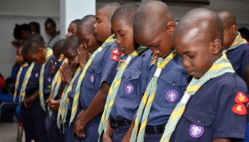Members of the St. Peter Claver Cub Scout Pack, bow their heads in prayer at the Scout Association of Jamaica National Founder's Day church service held on Sunday, February 23, at the Faith Cathedral Deliverance Centre, 104 Waltham Park Road, Kingston 10.