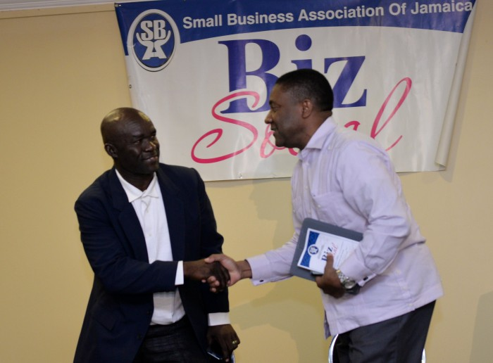 (left) Science, Technology, Energy and Mining Minister, Hon. Phillip Paulwell (right), is greeted by President of the Small Business Association of Jamaica (SBAJ), Hugh Johnson, at the SBAJ's Biz Social, held at the Knutsford Court Hotel, Chelsea Avenue, St. Andrew on September 24.