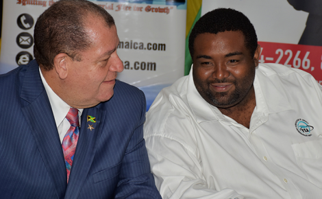 Finance and the Public Service Minister, Hon. Audley Shaw (left), speaks with Young Entrepreneurs Association of Jamaica (YEA) President, Ricardo James, at a policy proposal forum staged by the association on April 12 at the Jamaica Promotions Corporation (JAMPRO) headquarters in New Kingston.