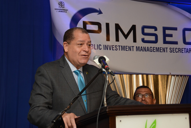 Finance and Public Service Minister, Hon. Audley Shaw, emphasises a point while addressing the Public Investment Management System (PIMS) launch and sensitization forum at the Knutsford Court Hotel in New Kingston, on June 2. Listening keenly is Planning Institute of Jamaica (PIOJ) Deputy Director General, Richard Lumsden, who chaired the function.