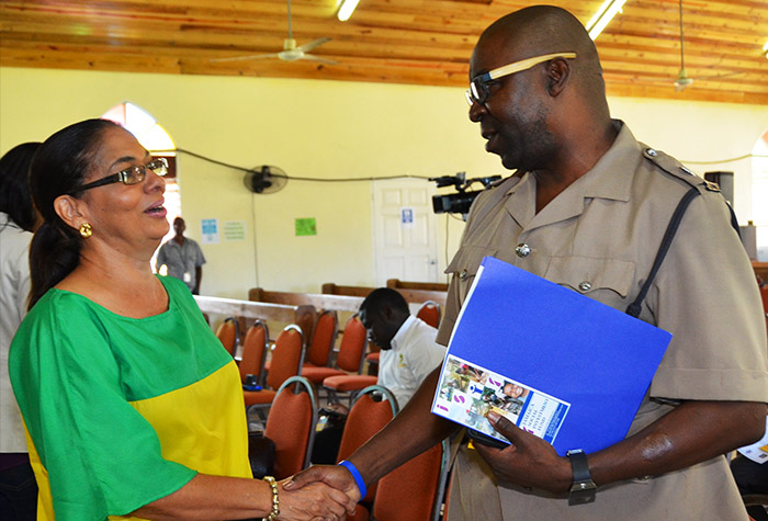 Member of Parliament for North East St Ann, Shahine Robinson (left) greets Police Superintendent, Steve Brown at the community launch of the Jamaica Social Investment Fund (JSIF) Integrated Community Development Project (ICDP), at the New Testament Church of God, Steer Town, St. Ann on Friday, February 27.  Over the next two to three months, JSIF will be in consultation with the community to determine the ICDP priorities for the 5 year project.