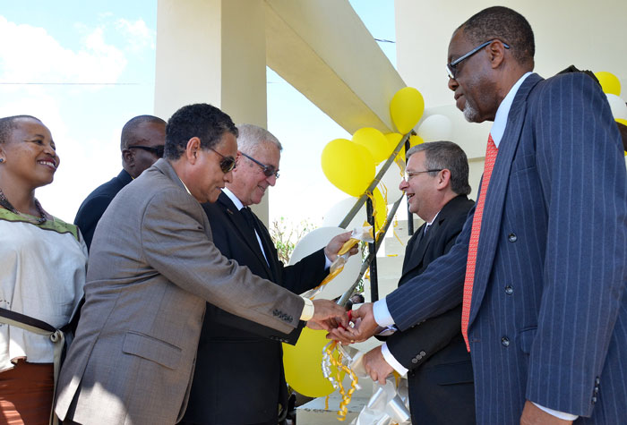 Min. Arscott, Min. Thwaites, Bernardo Guanche Hernandez, Cuban Ambassador to Jamaica and Winsett Thomas, Board Chairman, Garvey Maceo High School cuts ribbon for the opening of six form block at the school.