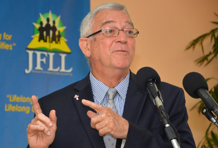 Education Minister, Hon. Rev. Ronald Thwaites, delivers the keynote address at Thursday's (July 24) launch of the Jamaican Foundation for Lifelong Learning's (JFLL) High School Diploma Equivalency (HSDE) Programme, at the agency's head office, South Camp Road, in Kingston.