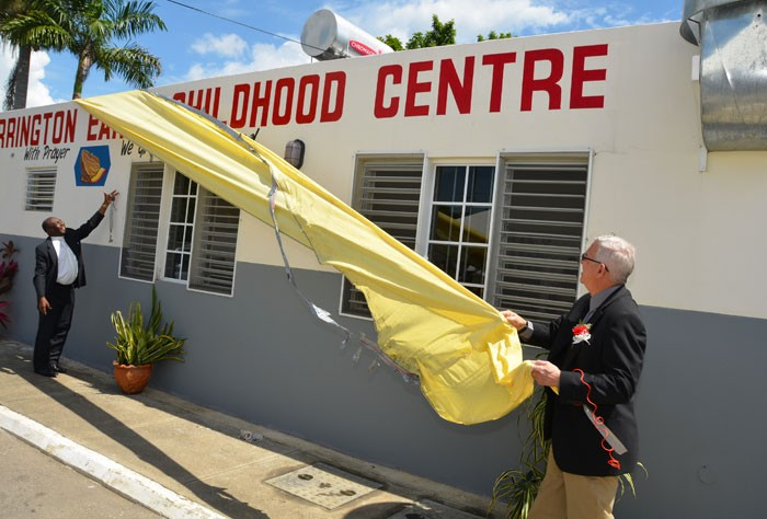 Minister of Education, Hon. Rev. Ronald Thwaites (right), is assisted by Rev. Lorrel Garwood to unveil the sign for the Torrington Early Childhood Centre in Westmoreland, which was opened on February 27. (FILE)