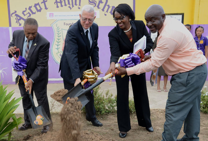Minister of Education, Hon. Rev. Ronald Thwaites (second left); late Mayor of Portmore, George Lee (left); Chairman, Ascot High School, Pauline McKenzie (second right); and Principal, Ascot High School, Cedric Murray, break ground for the sixth form block at the Ascot High School in  Greater Portmore, St. Catherine, on June 12.